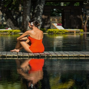 Mauritius Honeymoon Packages Shandrani Beachcomber Resort & Spa Woman Sitting By Spa Pool