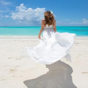 Mauritius Honeymoon Packages Shanti Maurice Resort & Spa Women On Beach