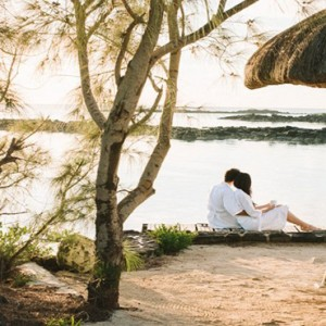 Paradise Cove - Luxury Mauritius Honeymoon Packages - Couple relaxing by ocean1