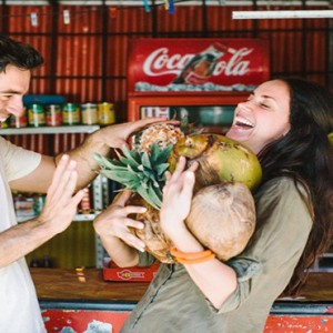 Paradise Cove - Luxury Mauritius Honeymoon Packages - couple buying coconuts