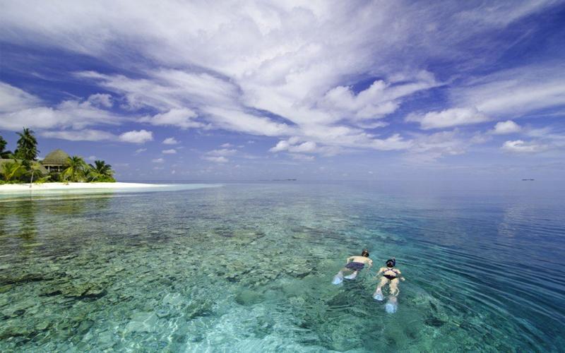 kandolhu island - luxury maldives honeymoon packages - travel insurance explained