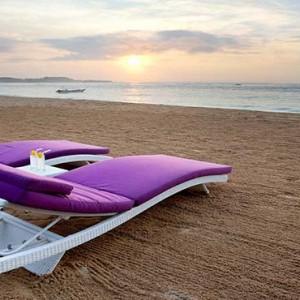 Amarterra Villas Bali Nusa Dua - Luxury Bali Honeymoon Packages - sun loungers on beach