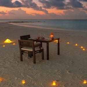 Atmosphere Kanifushi - Luxury Maldives Honeymoon Packages - Candlelit beach dining