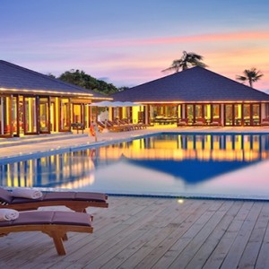 Atmosphere Kanifushi - Luxury Maldives Honeymoon Packages - Pool at night1