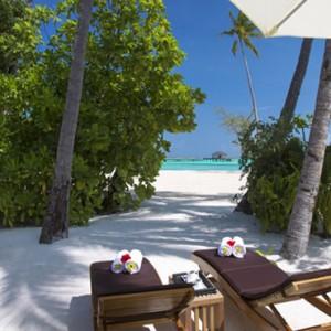 Atmosphere Kanifushi - Luxury Maldives Honeymoon Packages - Sunset Junior Suites beach