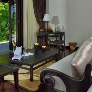 Atmosphere Kanifushi - Luxury Maldives Honeymoon Packages - Sunset Junior Suites interior living area