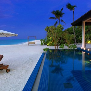 Atmosphere Kanifushi - Luxury Maldives Honeymoon Packages - Sunset Pool Villa exterior pool and beach at night