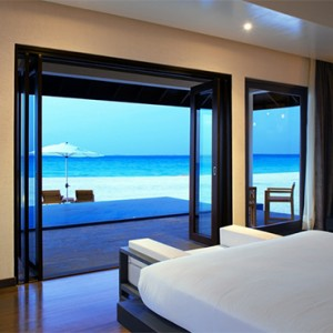 Atmosphere Kanifushi - Luxury Maldives Honeymoon Packages - Sunset Pool Villa interior bedroom