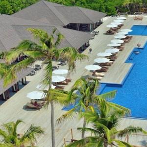 Atmosphere Kanifushi - Luxury Maldives Honeymoon Packages - aerial view of pool