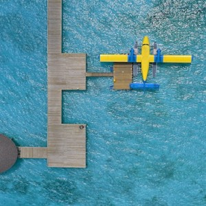 Atmosphere Kanifushi - Luxury Maldives Honeymoon Packages - aerial view of seaplane transfer