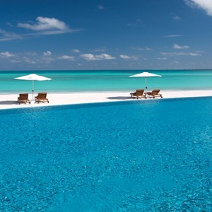 Atmosphere Kanifushi - Luxury Maldives Honeymoon Packages - infinity pool overview