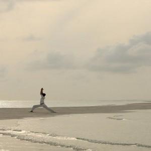 COMO Cocoa island - Luxury Maldives Honeymoon Packages - Yoga on beach