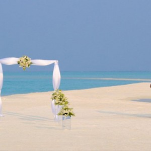 COMO Cocoa island - Luxury Maldives Honeymoon Packages - arch on the beach