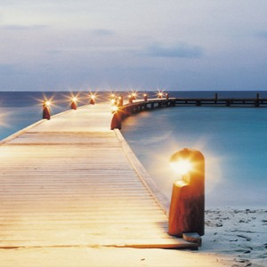 COMO Cocoa island - Luxury Maldives Honeymoon Packages - arrival jetty at night
