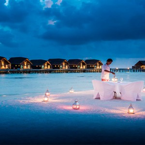 COMO Cocoa island - Luxury Maldives Honeymoon Packages - candlelit dinner on beach