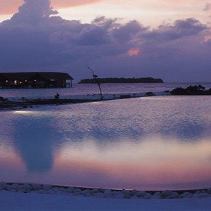 COMO Cocoa island - Luxury Maldives Honeymoon Packages - infinity pool at night