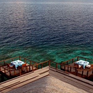 Coco Bodu Hithi - Luxury Maldives Honeymoon Packages - Aqua restaurant exterior dining