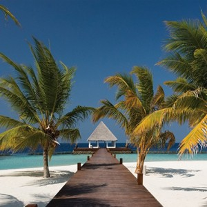 Coco Bodu Hithi - Luxury Maldives Honeymoon Packages - Beach area