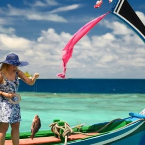 Coco Bodu Hithi - Luxury Maldives Honeymoon Packages - Catching fish