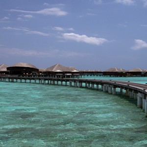 Coco Bodu Hithi - Luxury Maldives Honeymoon Packages - Coco Residence walkway to residence