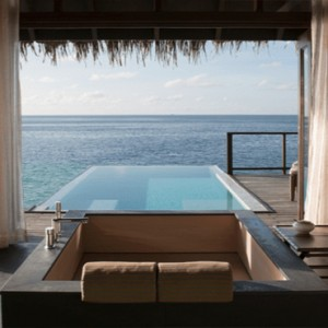 Coco Bodu Hithi - Luxury Maldives Honeymoon Packages - Escape Water Villa bathroom with a view