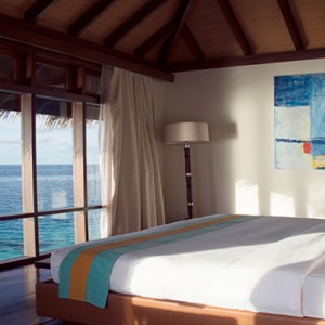 Coco Bodu Hithi - Luxury Maldives Honeymoon Packages - Escape Water Villa bedroom
