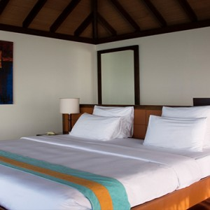 Coco Bodu Hithi - Luxury Maldives Honeymoon Packages - Escape Water Villa bedroom overview