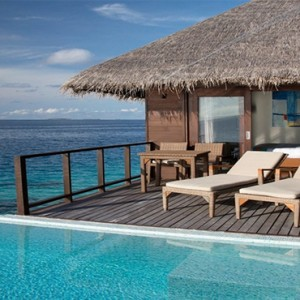 Coco Bodu Hithi - Luxury Maldives Honeymoon Packages - Escape Water Villa deck with pool