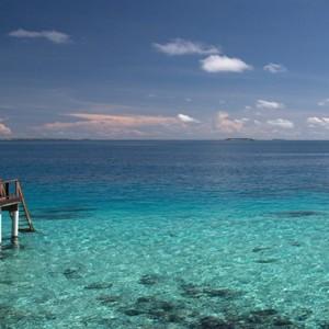 Coco Bodu Hithi - Luxury Maldives Honeymoon Packages - Escape Water Villa exterior lagoon