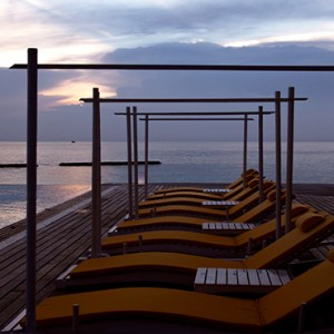 Coco Bodu Hithi - Luxury Maldives Honeymoon Packages - Latitude pool view at night