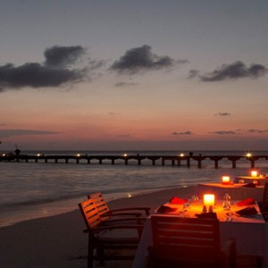 Coco Bodu Hithi - Luxury Maldives Honeymoon Packages - Private dining at night