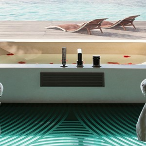 Coco Bodu Hithi - Luxury Maldives Honeymoon Packages - Spa massage room