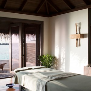 Coco Bodu Hithi - Luxury Maldives Honeymoon Packages - Spa massage room1