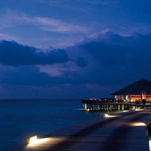 Coco Bodu Hithi - Luxury Maldives Honeymoon Packages - Stars restaurant exterior at night