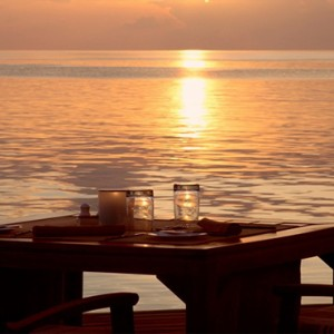Coco Bodu Hithi - Luxury Maldives Honeymoon Packages - dining at sunset