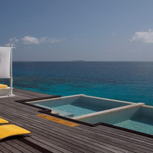 Coco Bodu Hithi - Luxury Maldives Honeymoon Packages - spa deck and pool