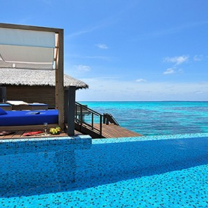 Coco Bodu Hithi - Luxury Maldives Honeymoon Packages - women in pool