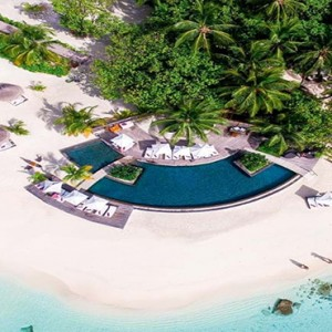 Constance Moofushi - Luxury Maldives Honeymoon Packages - Aerial View of Pool and beach