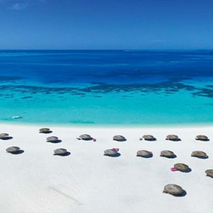 Constance Moofushi - Luxury Maldives Honeymoon Packages - Aerial View of beach and ocean