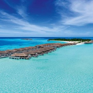 Constance Moofushi - Luxury Maldives Honeymoon Packages - Aerial View of water villas