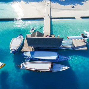 Constance Moofushi - Luxury Maldives Honeymoon Packages - Arrival jetty