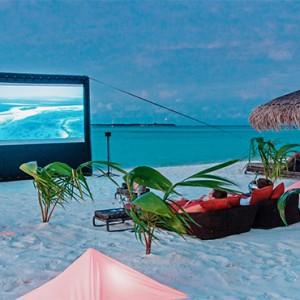 Constance Moofushi - Luxury Maldives Honeymoon Packages - Beach Cinema