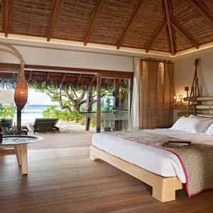 Constance Moofushi - Luxury Maldives Honeymoon Packages - Beach Villa bedroom