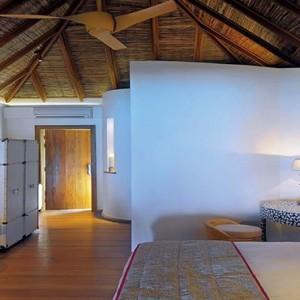 Constance Moofushi - Luxury Maldives Honeymoon Packages - Beach Villa bedroom1