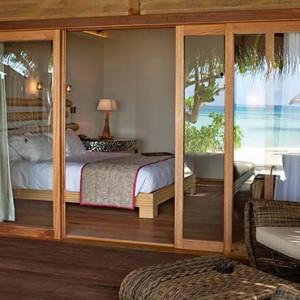 Constance Moofushi - Luxury Maldives Honeymoon Packages - Beach Villa deck view