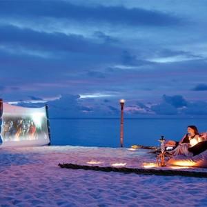Constance Moofushi - Luxury Maldives Honeymoon Packages - Beach cinema1