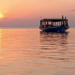 Constance Moofushi - Luxury Maldives Honeymoon Packages - Dhoni boat excursion