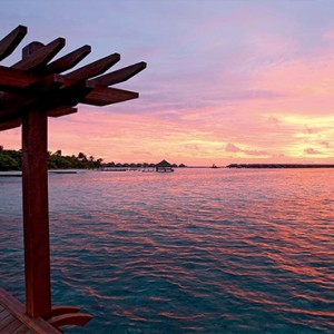 Constance Moofushi - Luxury Maldives Honeymoon Packages - Indian ocean sunsets