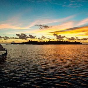 Constance Moofushi - Luxury Maldives Honeymoon Packages - Sailing dhoni sunset