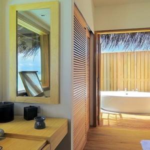 Constance Moofushi - Luxury Maldives Honeymoon Packages - Senior Water Villa bathroom